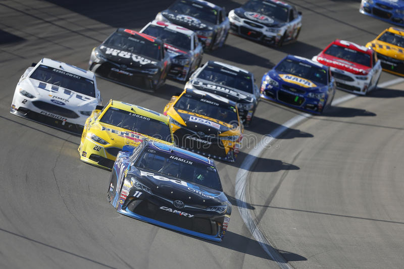 NASCAR: Mar 06 Kobalt 400. Las Vegas, NV - Mar 06, 2016: Denny Hamlin (11) leads the pack through the turn during the Kobalt 400 at the Las Vegas Motor Speedway royalty free stock photography