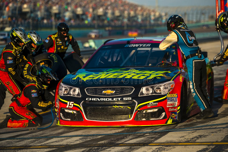 NASCAR: Nov 20 Ford EcoBoost 400. Homestead, FL - Nov 20, 2016: Clint Bowyer brings the #15 5 Hour Energy Chevy into the pits for maintenance during the Ford royalty free stock photos