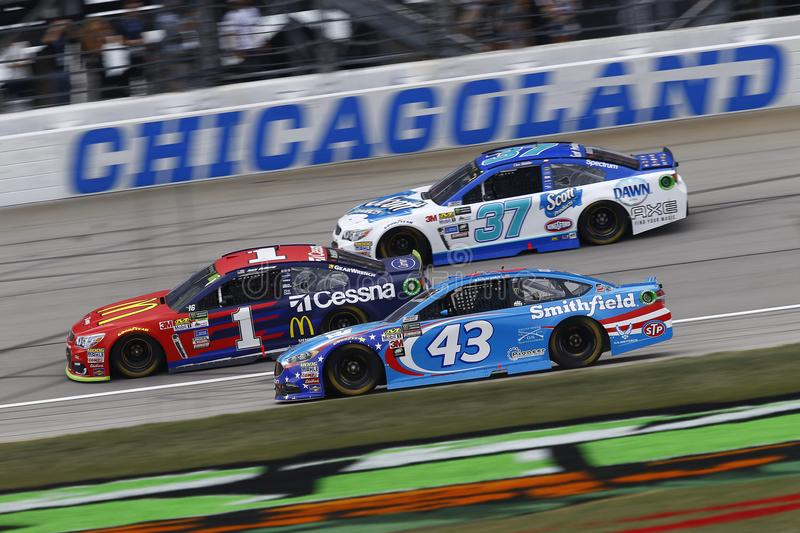 NASCAR: September 17 Tales of the Turtles 400. September 17, 2017 - Joliet, Illinois, USA: Jamie McMurray 1, Aric Almirola 43 and Chris Buescher 37 battle for stock photos