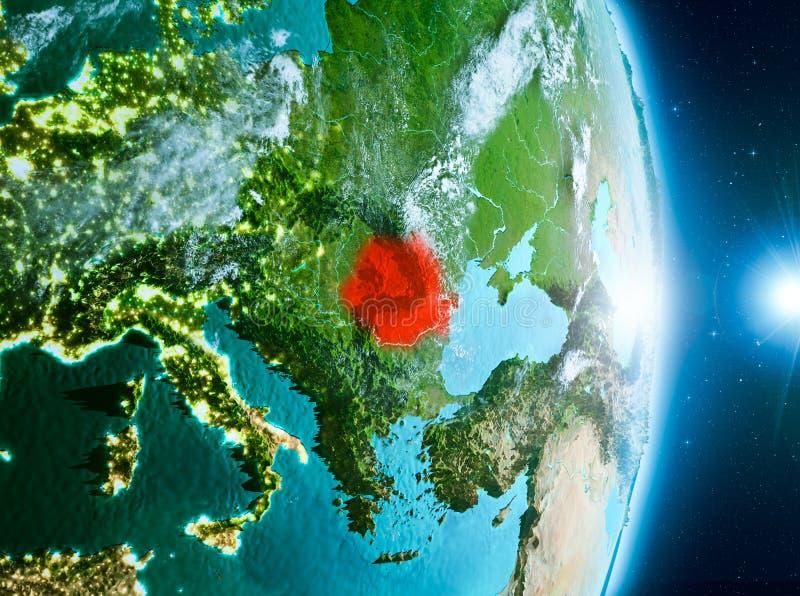 Nascer do sol acima de Romênia na terra do planeta fotos de stock