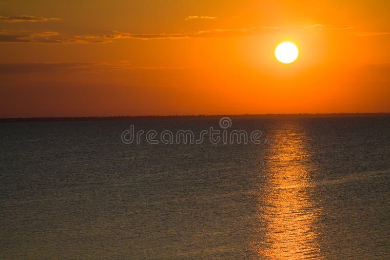 Nascer do sol alaranjado imagem de stock