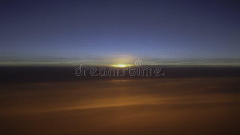 Nascer do sol e nuvens imagens de stock