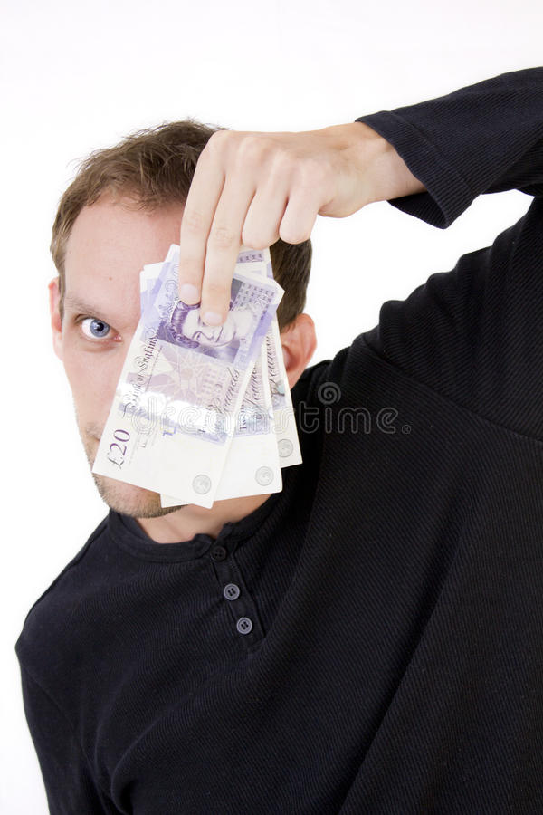 Nascondendosi dietro i soldi immagine stock