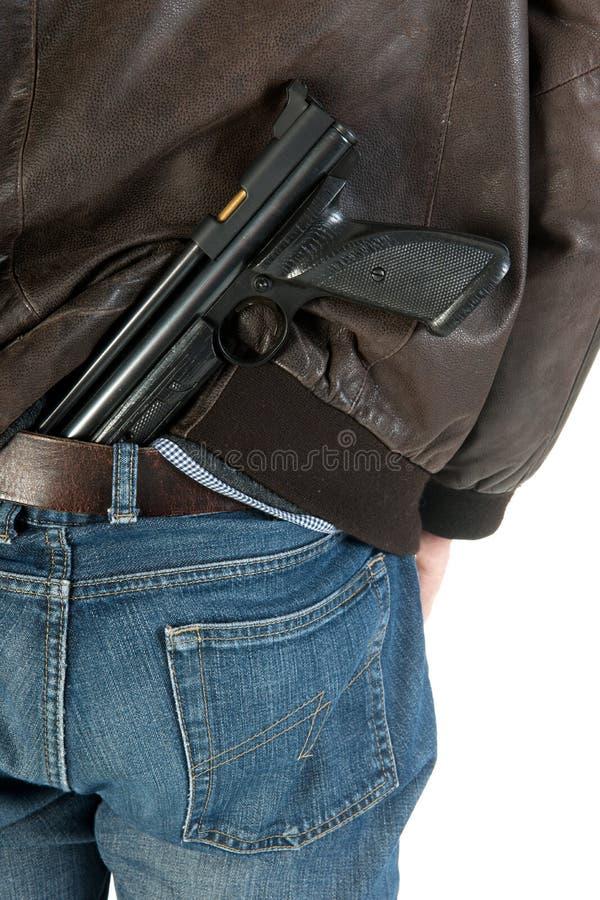 Nascondere Una Pistola Fotografia Stock