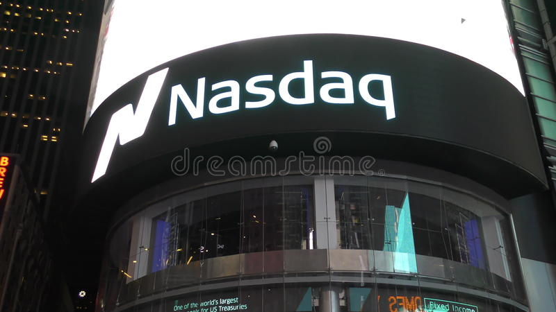 Nasdaq exchange, new York City. New York, USA - June 17: Nasdaq exchange sign glows above New York City's Times Square on June 17, 2015 filmed in 4K Ultra HD stock video footage
