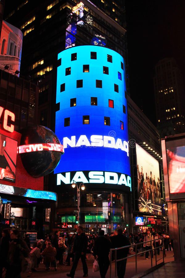 NASDAQ Market Building. This photo shows the front of the NASDAQ Market Building during a typical evening at Time Square, New York City, USA. NASDAQ was the stock image