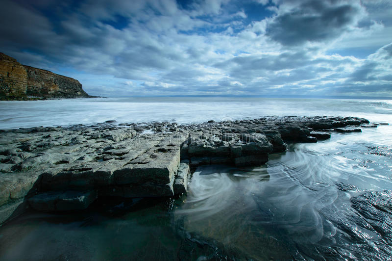 Nash Point, Wales. Rocks in front of the cliffs at Nash Point, Wales stock images
