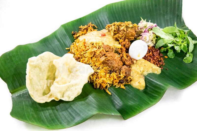Nasi briyani with lamb mutton served on banana leaf plate. Delicious nasi briyani with lamb mutton served on banana leaf plate, popular food in Malaysia royalty free stock photos