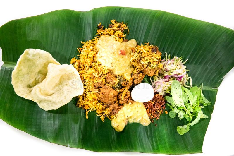 Nasi briyani with lamb mutton served on banana leaf plate. Delicious nasi briyani with lamb mutton served on banana leaf plate, popular food in Malaysia stock images