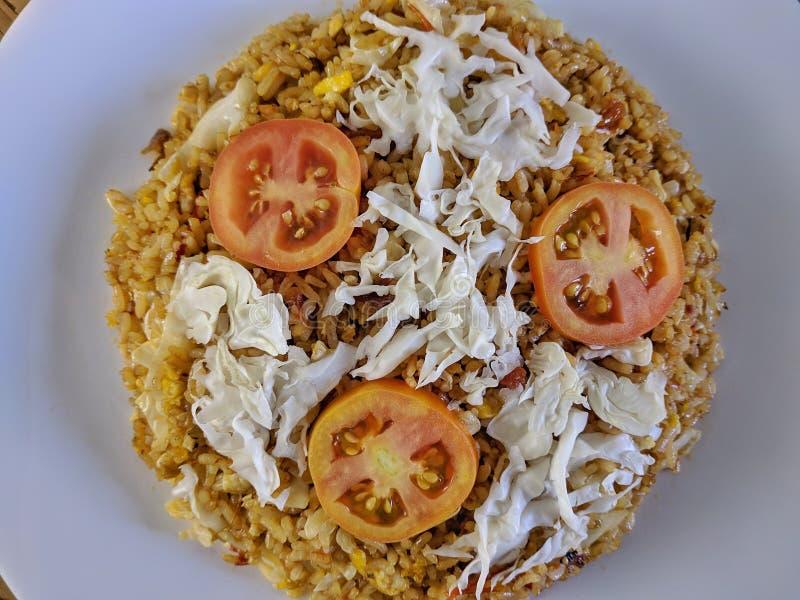 Nasi Goreng är indonesisk berömd mat för frukost royaltyfri bild