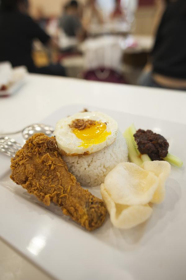 Nasi Lemak, a Malay fragrant rice dish cooked in coconut milk, served with side dishes royalty free stock photography