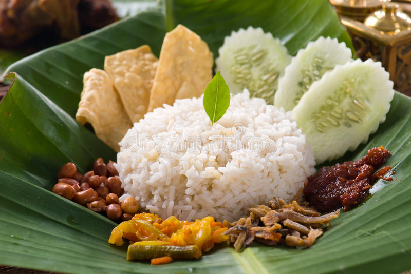 Nasi lemak, a traditional malay curry paste rice dish served on. A banana leaf stock photos