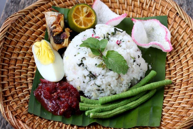 Nasi Ulam - Malay traditional herb rice. stock photo