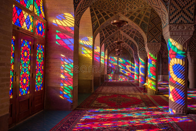 Nasir Al-Mulk Mosque in Shiraz, Iran. SHIRAZ, IRAN - OCTOBER 23, 2016 : Colorful light through stained glass window inside Nasir Al-Mulk Mosque Pink Mosque, a royalty free stock photography