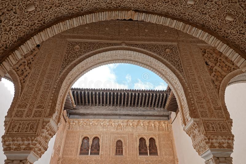 Nasrid palace Court of the Myrtes at the Alhambra in Granada, Andalusia. Arabic wall carvings in the Palacio Arab at the Court of the Myrtles royalty free stock images