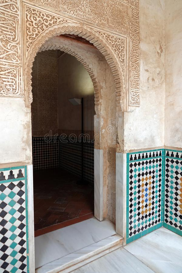 Nasrid palace door at the Alhambra in Granada, Andalusia. Door decorated with arabesque ornaments and mosaic tiles in the Palacio Arab at the Court of the stock photos