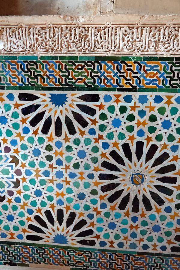 Nasrid palace Mexuar tiles at the Alhambra in Granada, Andalusia. Coloured mosaic tiles at the Mexuar which was the public reception hall of the Alhambra, where royalty free stock image