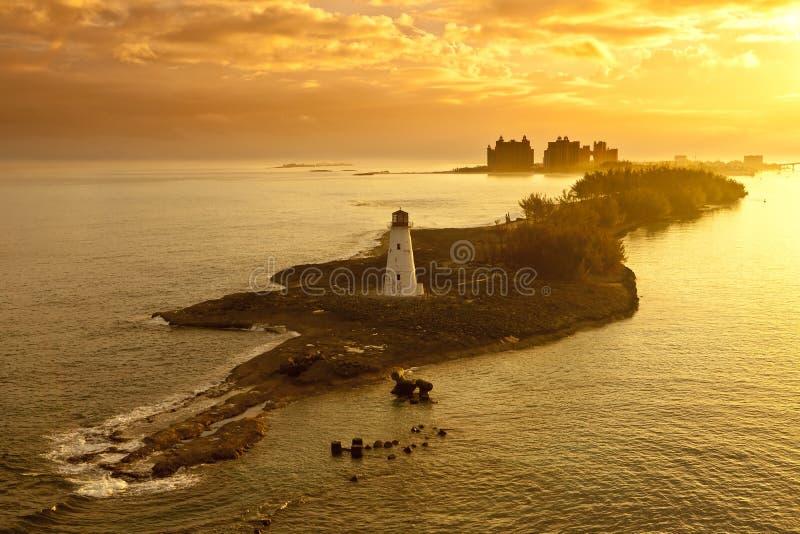Nassau, bahamas, at dawn. Lighthouse and resort on nassau, bahamas at dawn royalty free stock photography