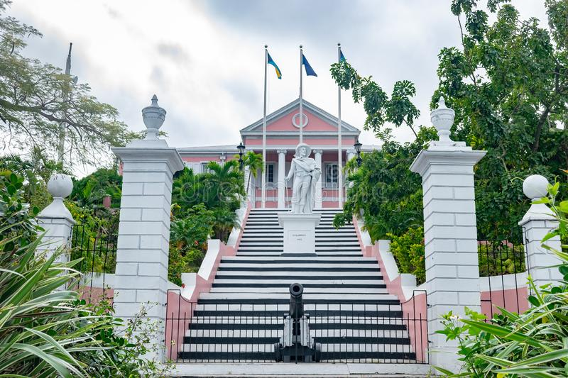 Government House in Nassau, Bahamas. Nassau, Bahamas - December 02 2015: The Government House in Nassau, Bahamas, painted in pink, with statue of Christopher royalty free stock images