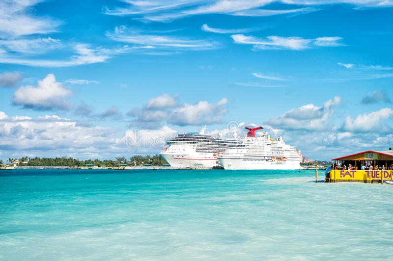 Nassau, Bahamas - January 07, 2016: cruise ships in port. Ocean liners in Caribbean sea on sunny blue sky. Summer vacation on trop royalty free stock photography