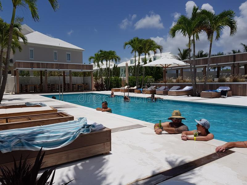 NASSAU, BAHAMAS. 17 of June of 2018. People chilling and relaxing in a pool in Palm Cay resort in Nassau island. Bahamas. People chilling and relaxing in a pool stock photos