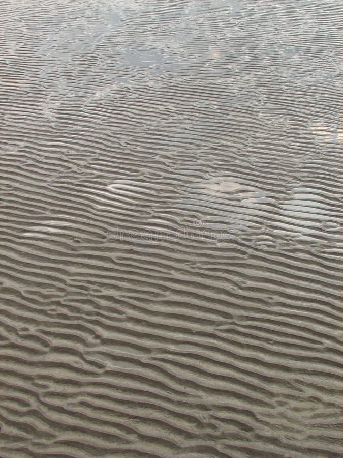 Nasse Sand-Muster lizenzfreie stockfotografie