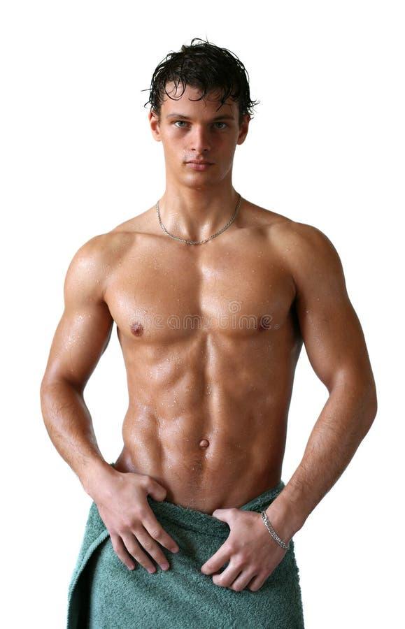Nasser muskulöser Mann eingewickelt in einem Tuch stockbilder