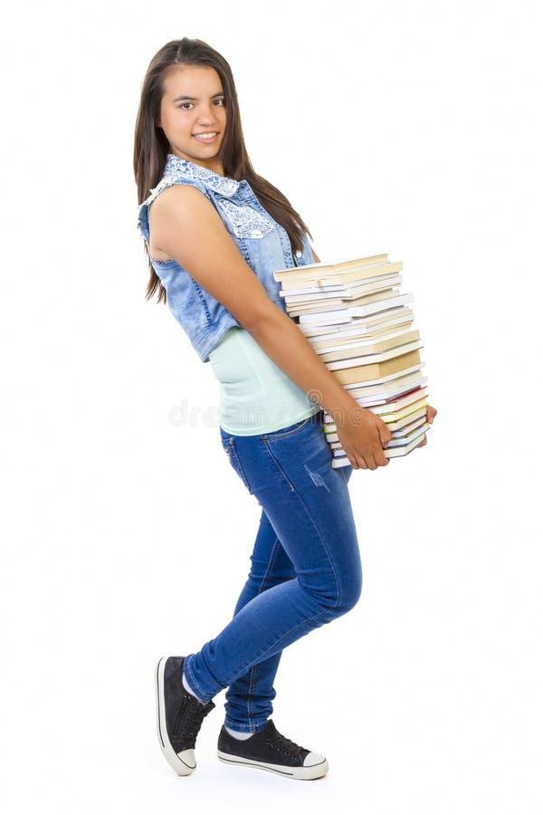 Nastolatek dziewczyna z książkami odizolowywać nad bielem obraz stock