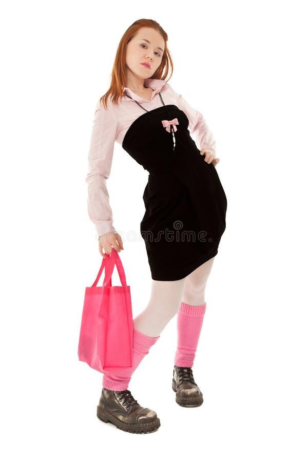 Nastolatek fajtłapy dziewczyna patrzeje kamera w kolorowych ubraniach fotografia stock