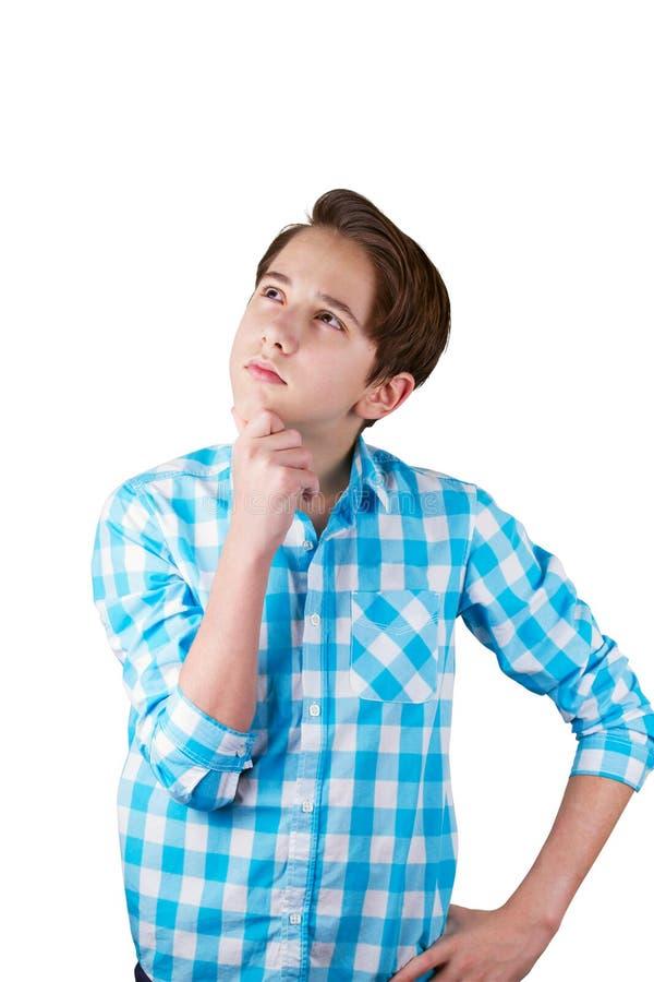 Nastolatek jest wątpliwy lub główkowanie o coś fotografia stock