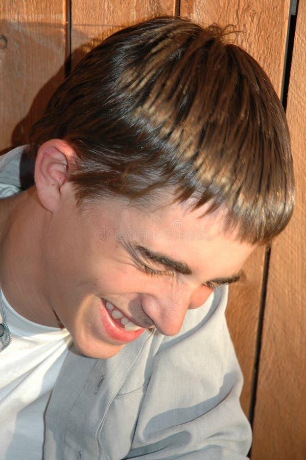 nastolatek się śmieje zdjęcia stock