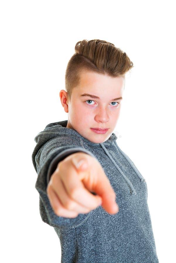 Nastolatek wskazuje wewnątrz kamera obraz royalty free