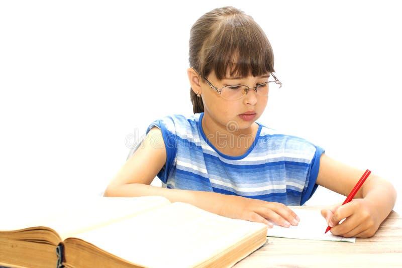 Nastolatek z książkami na białym tle, obraz stock
