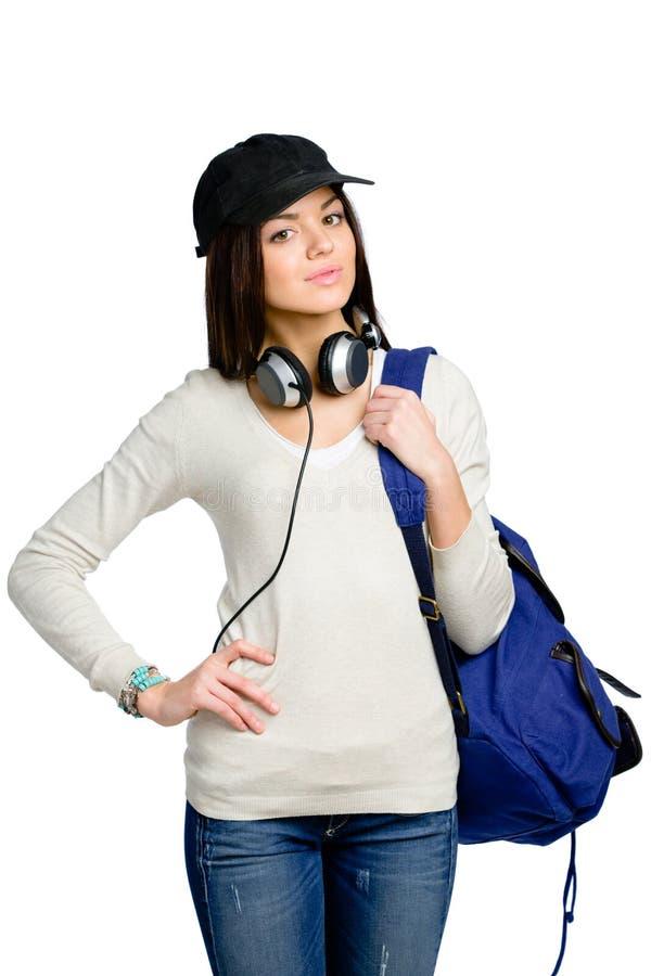 Nastolatek z słuchawkami i plecakiem w osiągającej szczyt nakrętce zdjęcie stock