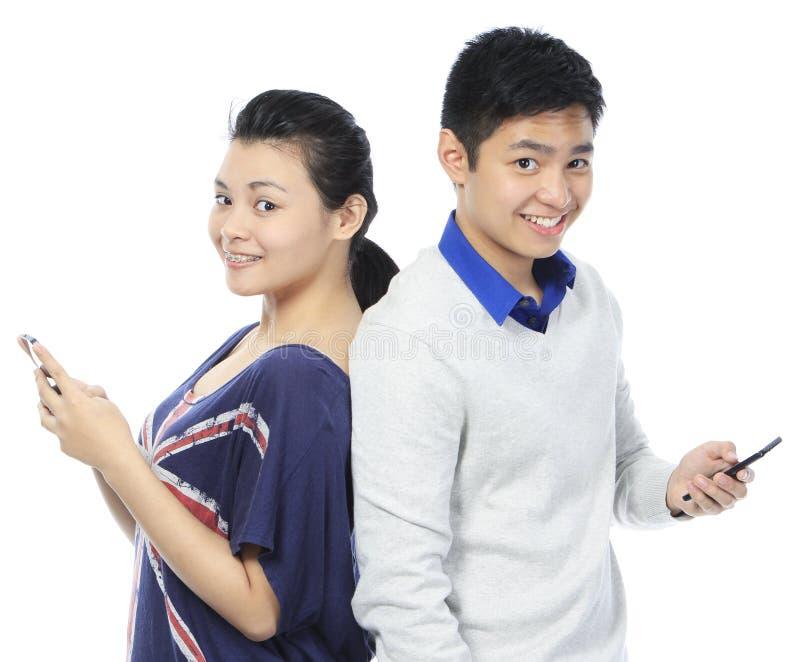 Nastolatków Texting obraz stock