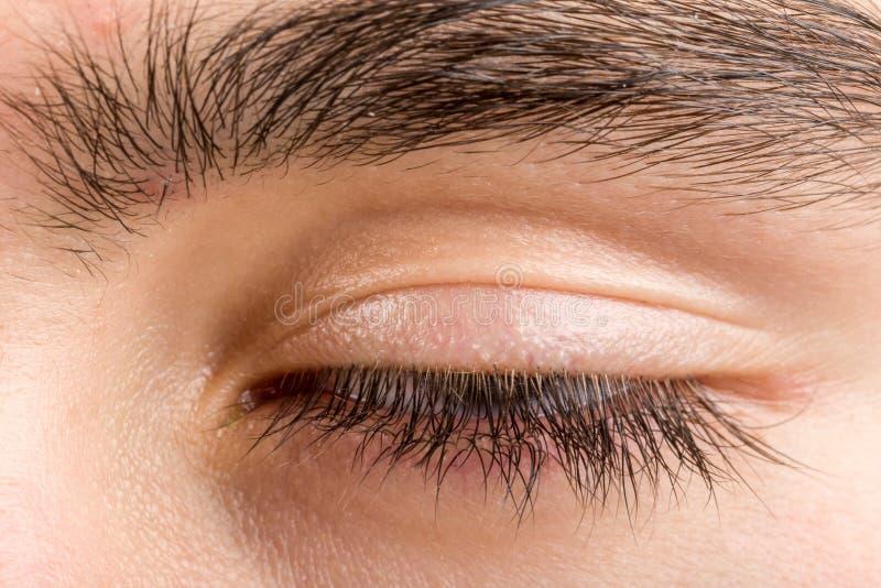Nastolatka mężczyzna oko makro- zdjęcie royalty free