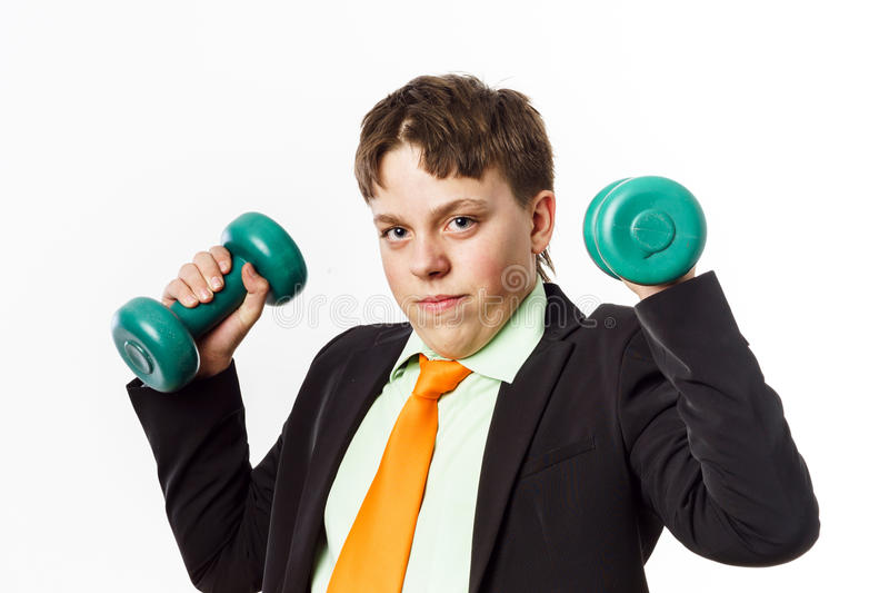 Nastoletni chłopak ubierał w biurowym kostiumu robi sportów ćwiczeniom zdjęcie royalty free