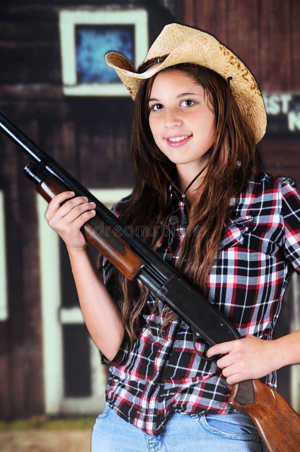 Nastoletni Cowgirl z pistoletem obraz stock