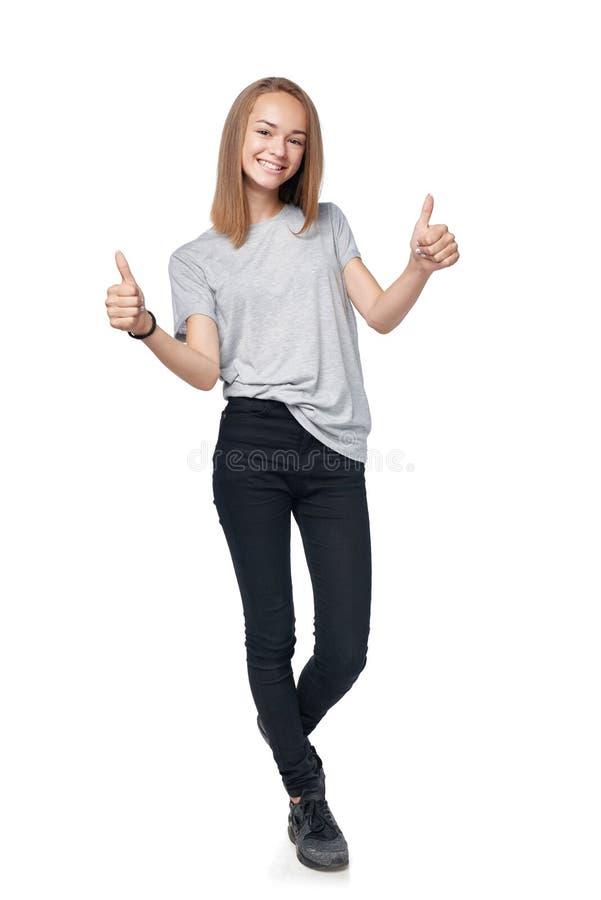 Nastoletnia dziewczyna pokazuje kciuk up podpisuje zdjęcia stock