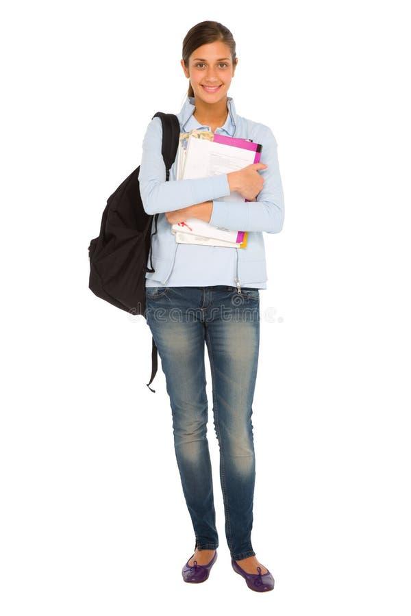 Nastoletnia dziewczyna z plecakiem i książkami obrazy royalty free