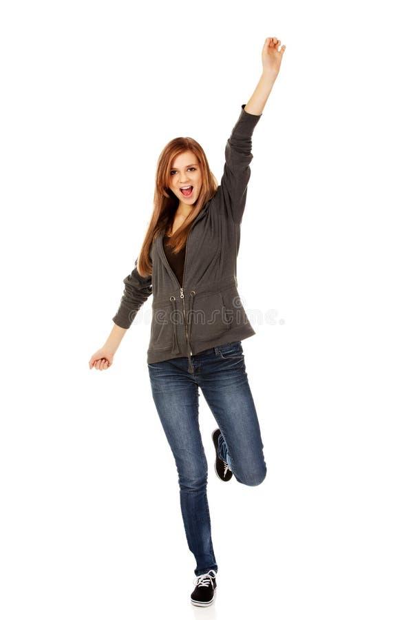 Nastoletnia kobieta z ręką up fotografia royalty free