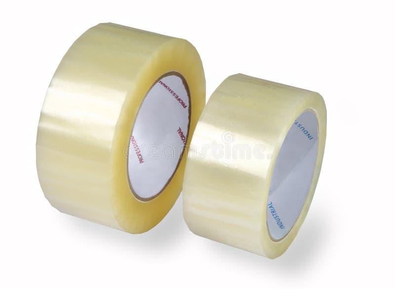 Nastri d'imballaggio, due rotoli del nastro trasparente, immagine isolata o fotografie stock libere da diritti