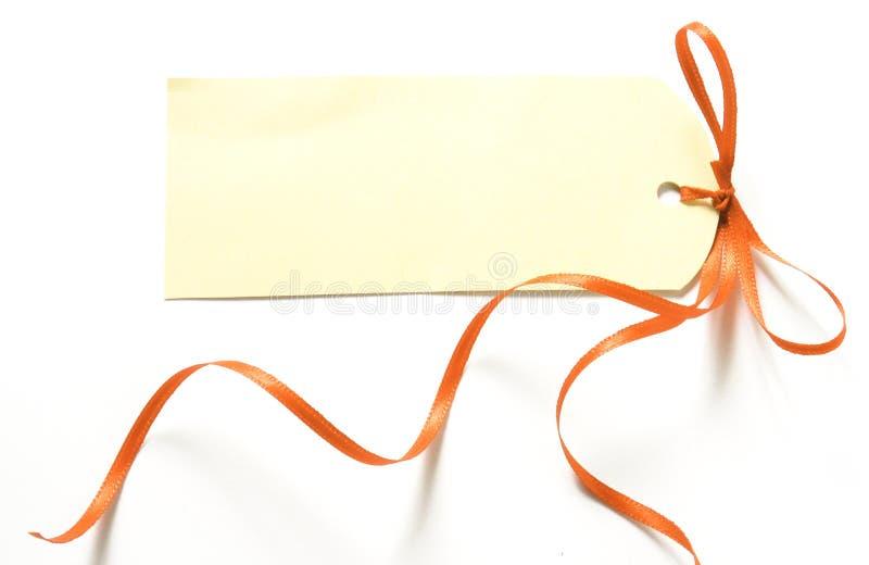 Nastro arancione con il contrassegno fotografie stock libere da diritti