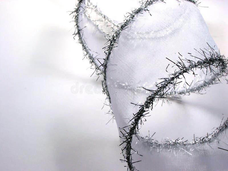 Nastro d'argento di natale su bianco fotografia stock