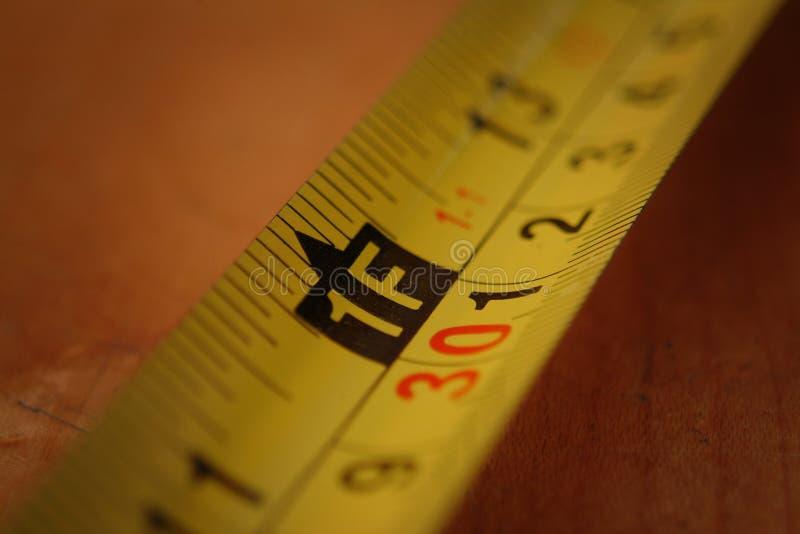 Download Nastro di misurazione fotografia stock. Immagine di pollice - 204784