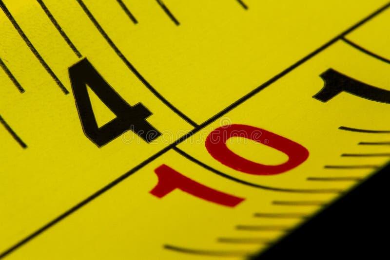 Nastro di misurazione del macro colpo in un'immagine del primo piano fotografie stock libere da diritti
