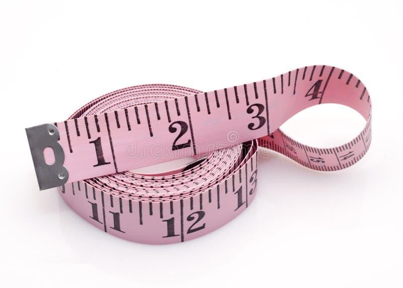 Nastro di misurazione rosa fotografia stock