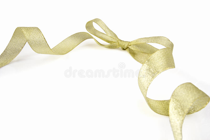 Nastro ed arco dorati fotografia stock libera da diritti