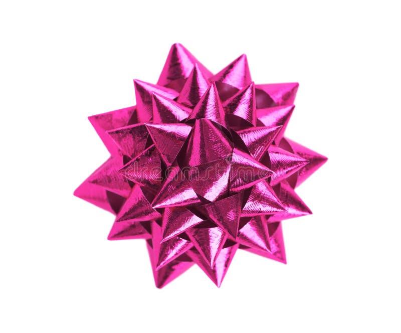 Nastro rosa dell'arco del regalo di Natale isolato sui precedenti bianchi immagini stock