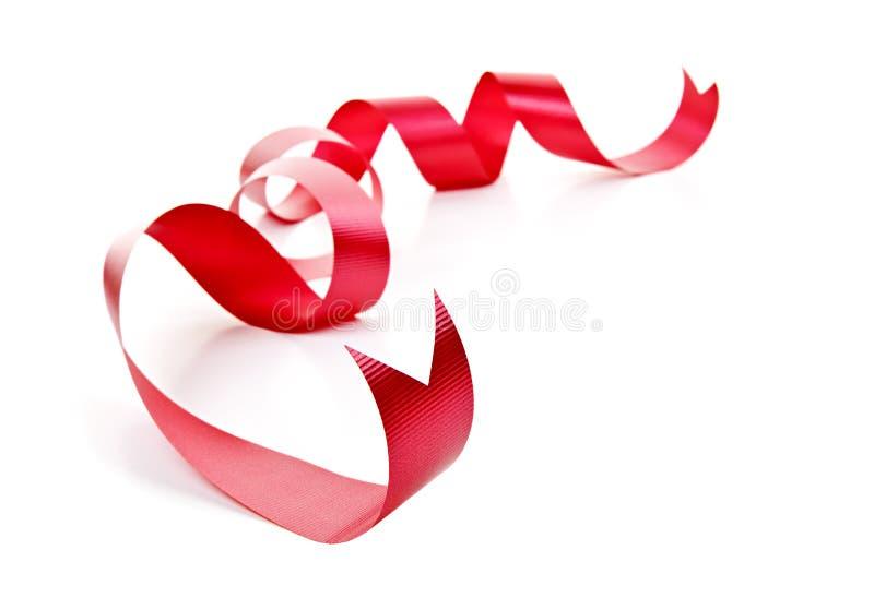 Nastro rosso arricciato di festa fotografie stock